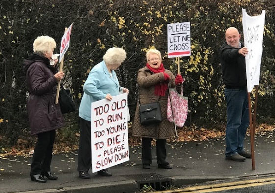 Residents protest against speeding cars near Bush Fair