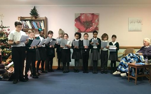 Latton Green students sing for residents at care home