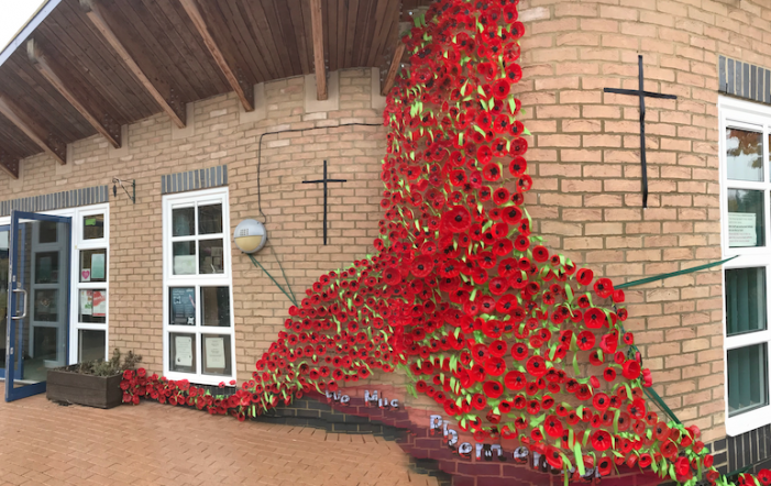 Holy Cross Primary create memorial of poppies to the fallen of WW1