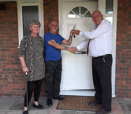 The keys to a newly created council home in Harlow handed over to tenants