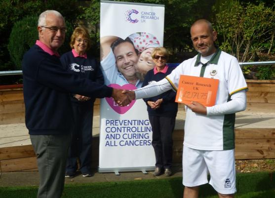 Harlow bowler hands over charity cheque after marathon bowlathon