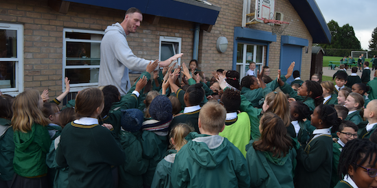 World's tallest basketball player visits Holy Cross Academy