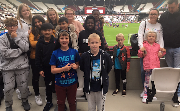 Young Harlow footballers experience football match thanks to free tickets