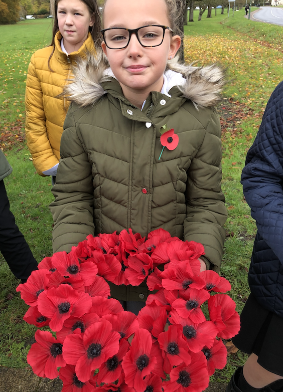 Pupils gather to remember the fallen