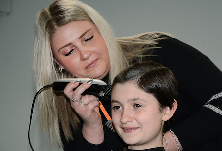 Brave Molly raises hundreds for charity by having her hair shaved off