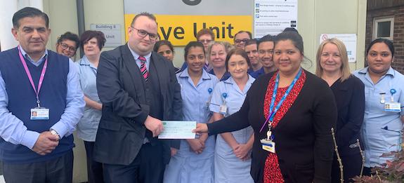 Harlow Opticians make generous donation to hospital's Eye Unit