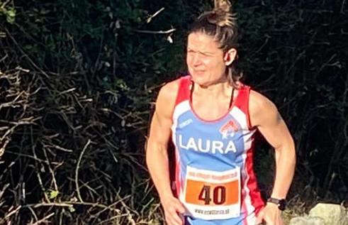 Athletics: Laura toughs it  out on the coast as first female home